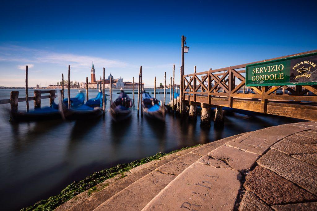 view of the Church of San Giorgio Maggiore on the island of the San Giorgio Maggiore with gondolas, Venice, Italy