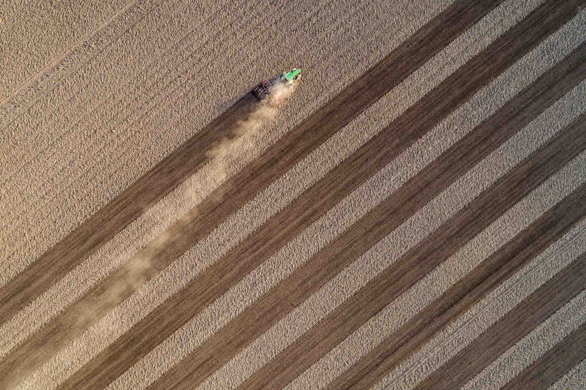 Aerial flight of field with tractor